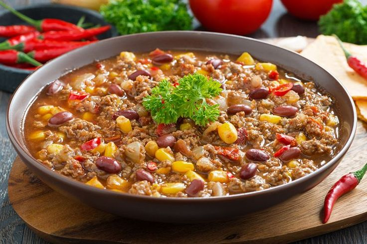This Slow Cooker Fiesta Chili Supper calls for clean ingredients like red bell peppers, chili powder, chipotle, and lime.