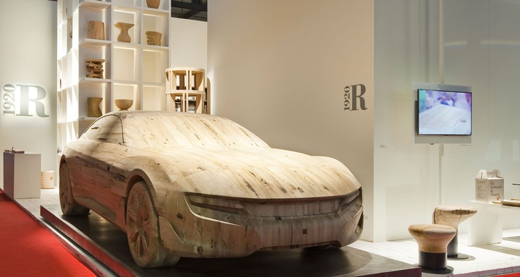 """On April 17, 2012 the new Cambiano concept car,  designed by Pininfarina was presented at the Salone Internazionale del Mobile in Milan.    It was created by SCM Group, Riva 1920 and Alphacam.    The interiors are made entirely of Briccola of Venice wood.    For the occasion, Mr Paolo Pininfarina unveiled and """"branded"""" the car, wholly made of wood."""