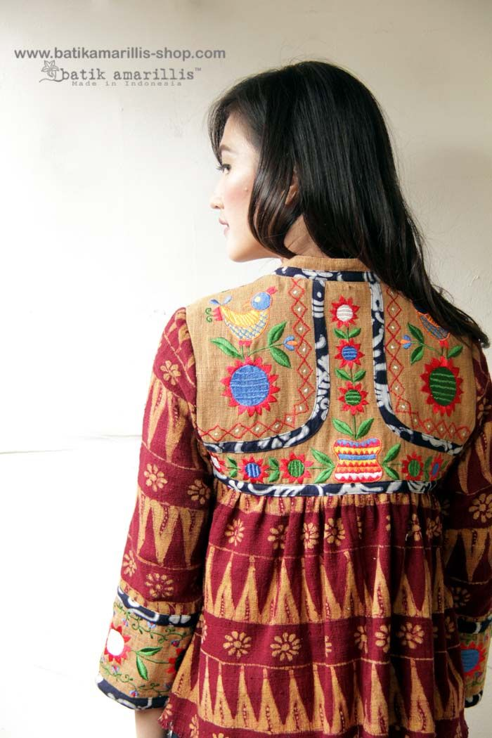 Batik Amarillis  Shikhara jacket In Beautiful ukrainian embroidery on Raw tenun gedog Tuban and Tenun Gedog Tuban which also features beautiful & colorful tassels This is Traditional Rabari ( Indian community in Gujarat ) male outfit's inspired ,consists of a fitted bodice with loosely gathered pleats down below with our patchwork's trademark, with front & back yoke make this tribal Look so unique & special