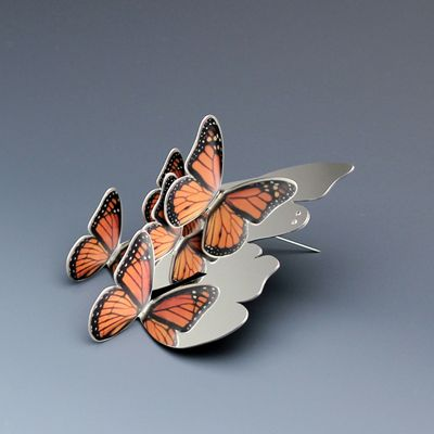 butterfly brooch by Heather Bayless.  very clever use of reflection in this design!