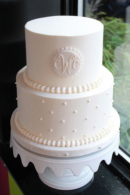 Monogrammed Wedding Cake by Whipped Bakeshop, I'd replace the pearl look with navy ribbon