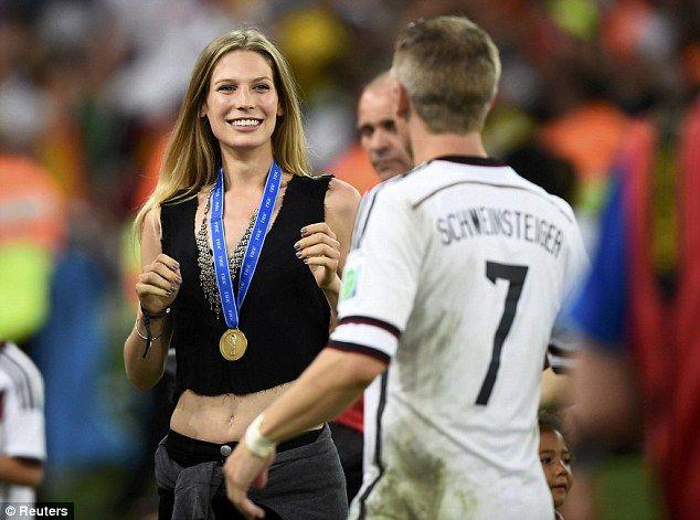 Greet: Germany's Bastian Schweinsteiger sees his girlfriend Sarah Brandner after the win