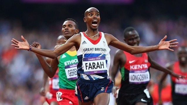 Mo Farah of Great Britain crosses the finish line to win gold ahead of Dejen Gebremeskel of Ethiopia and Thomas Pkemei Longosiwa of Kenya in the men's 5000m Final on Day 15 of the London 2012 Olympic Games at the Olympic Stadium.