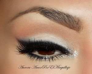 1. Prime your eyelids with a base or corrector 2. Apply Mylar e/s of MAC on brow bone and mobile eyelid 3. Line your top lashes with an Black Gel Liner & blend the edges 4.Set the black eyeliner with a Carbon e/s of MAC 5.Blur a little amount of Carbon e/s below lower lashes 6.Place a white bright pigment on the inner corner  7. Apply false lashes like Ardell Demi Wispies 8. Finish the look adding black mascara.
