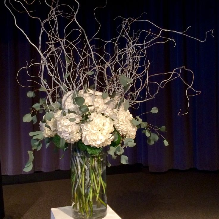 White winter altar arrangement with branches and hydrangea
