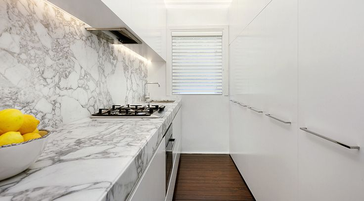 White marble kitchen. Design by Sarah Blacker Architect. Photo Anneke Hill.