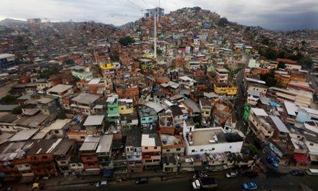 The Teleferico cable car system soars over the Alemão favela.