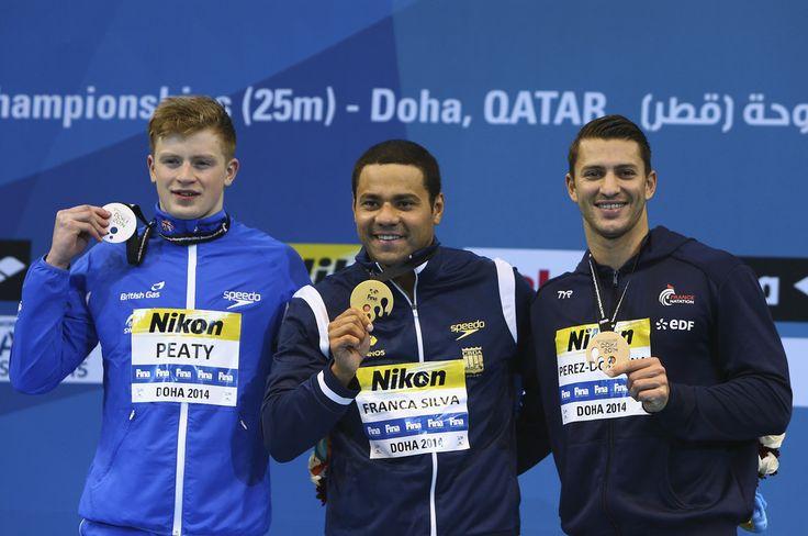 (L-R) Adam Peaty of Great Britain, Felipe Franca Silva of Brazil and Giacomo Perez-Dortona of France
