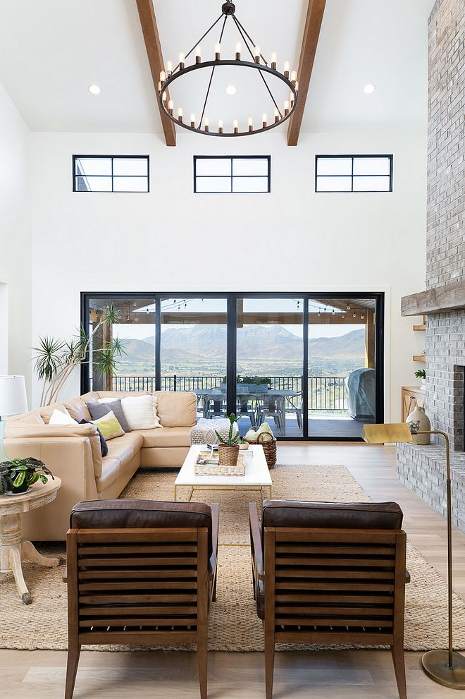 High Ceiling Two Story Living Room Chandelier And Windows Grey