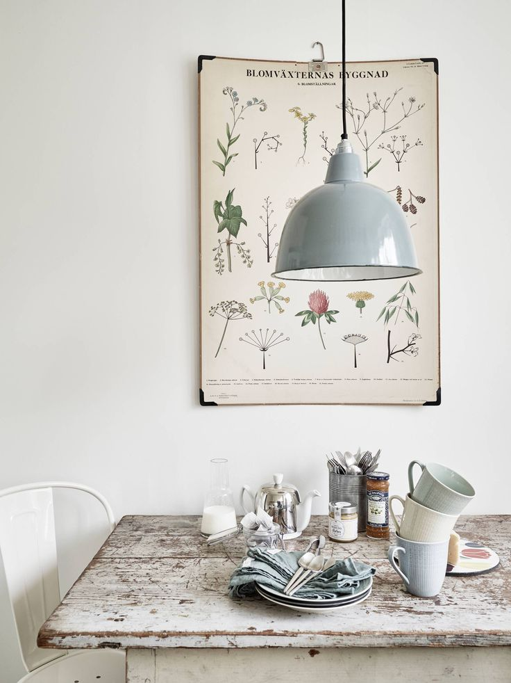 dining: rustic dining table, grey pendant lamp, crockery