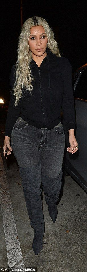 Stunner: Kim, who hit the pavement in pointed heeled boots, styled her long platinum tress...