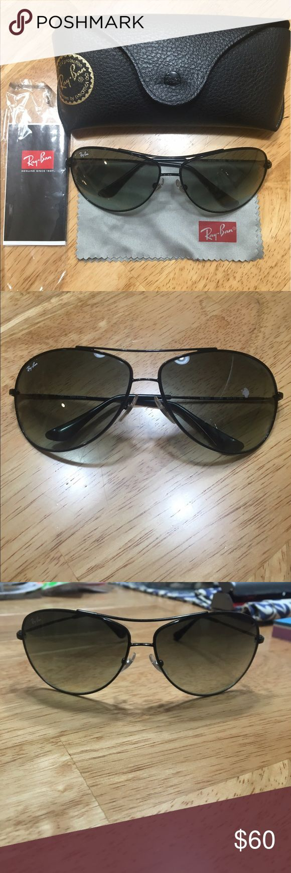Authentic Ray-Ban Black Aviator Sunglasses Authentic black metal framed Ray-Ban aviator sunglasses. Wore twice. Comes with original case (it is a little broken at the snap, but still closed shut), pamphlet, and Ray Ban cloth. Ray-Ban Accessories Sunglasses