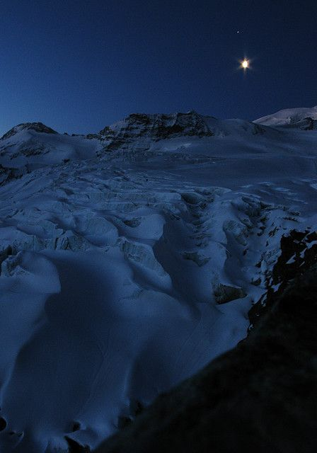 Fee glacier at dawn, in the moonlight, Saas Fee, Switzerland.