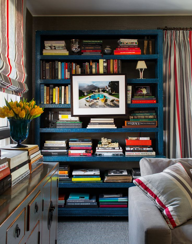The Fieldens bought this lacquered linen bookshelf, one of a pair, from an auction of Brooke Astor's belongings. It was designed by Albert Hadley. Hanging from it is a Slim Aarons print.