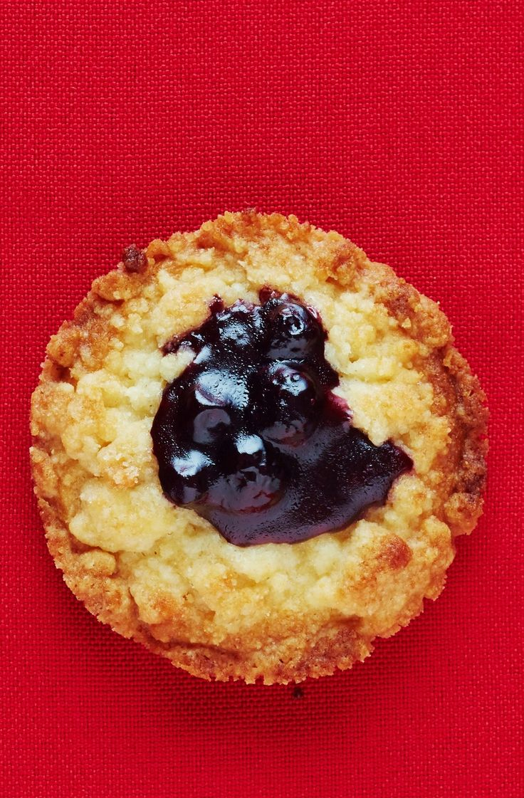 Dorie Greenspan's Classic Jammer Cookies Recipe. These delicious holiday cookies are made with a vanilla sablé dough, topped with thick jam, surrounded by tender, crumbly streusel. Great ideas for recipes to add to your list of things for your DIY Homemade Christmas cookie plate!