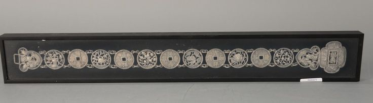 Chinese silver belt made up of silver style coins and dragon buckle.