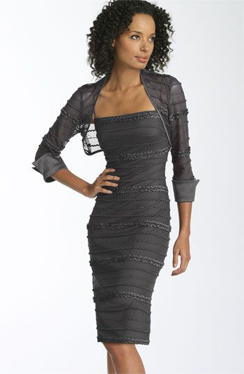 Ruffled stripes with sequined accents pattern a spaghetti-strap sheath dress with a coordinating mesh bolero.