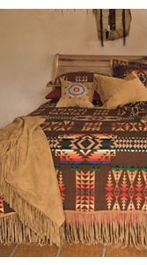 You could change the colors of the walls so many times with that blanket! I love it!
