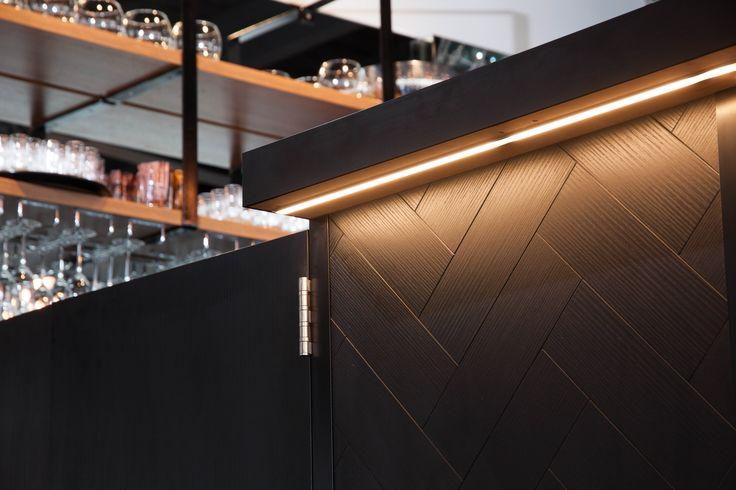 Marina Bar, Tairua featuring Melteca Black in Puregrain finish (counter front), Melteca Oiled Legno (shelving) and Formica laminate in Black (back countertop)