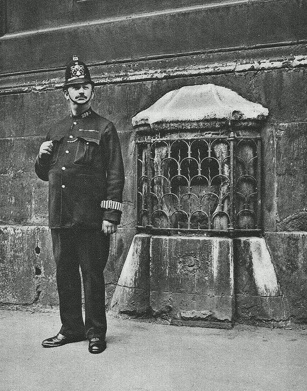 City of London Police Constable and the 'London Stone'.