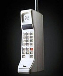 """1985 – Motorola DynaTAC  """"I don't think the very first mobile phone can really be called """"mobile"""". It basically resembled a big-ass brick with an even bigger-ass briefcase-sized battery and receiver pack that was almost impossible to lug around. Therefore, the 'yuppies' (young businessmen) only used them in the car. Unfortunately, the mobile phone cost more than the car."""" -- New Media Technologies for Dummies Written by a noob, for the noobs!!"""