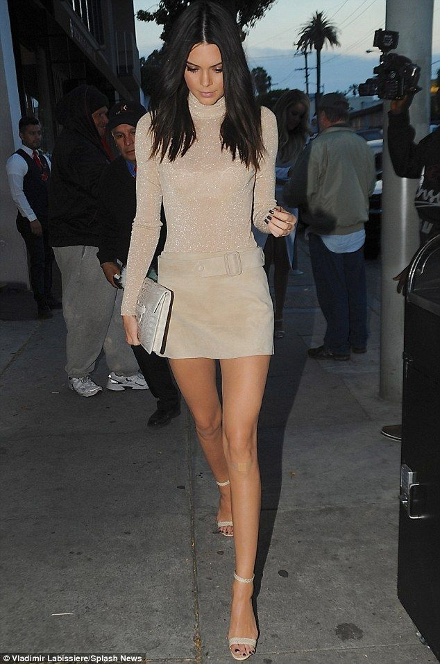 Stylish strut:Kendall Jenner brought her signature catwalk to the sidewalks of Craig's Restaurant in Los Angeles on Thursday where she was celebrating her Calvin Klein campaign with her family