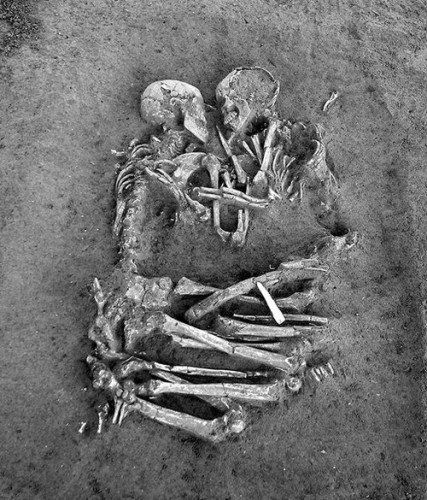 "This famous photograph is of the ""Lovers of Valdaro,"" two neolithic lovers locked in an eternal embrace. The human obsessions of love and death are equally aroused by this powerful image and the mysterious story behind it."