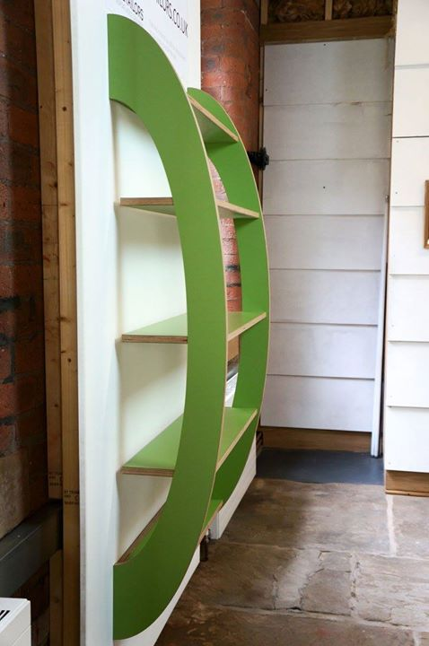 "Creative concept for curved shelves: ""Ellipse"" designed by Dovetailors using Formica@ Laminates in Leaf Green  http://ift.tt/2fOnclh #furniture #design"