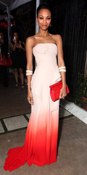 Zoe Saldana    WHAT SHE WORE    Saldana played up the colors of her ombre Givenchy couture gown with a bold red clutch and nude double cuffs-- love it