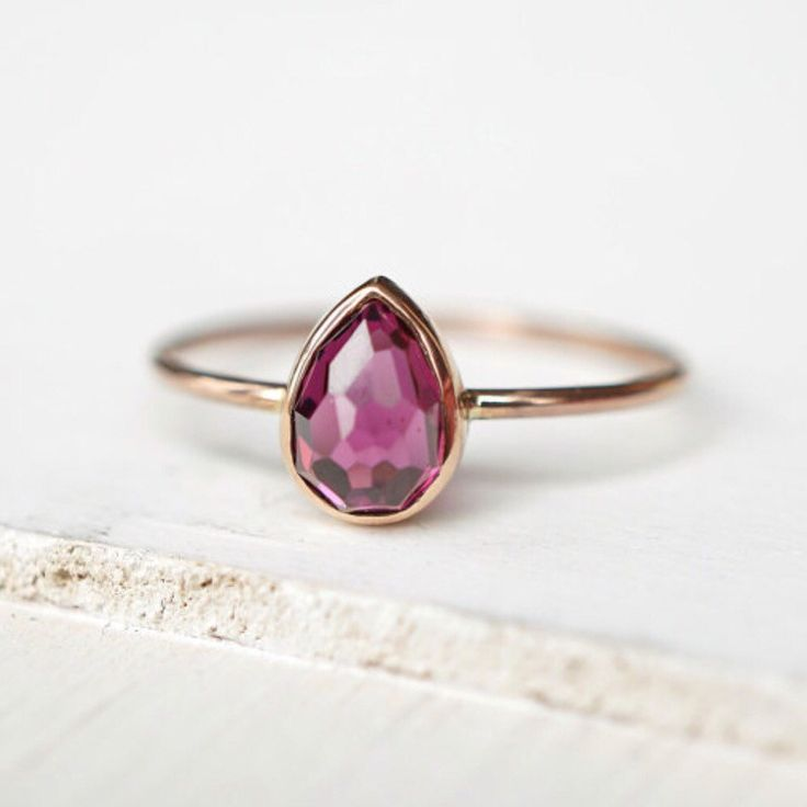 Pretty in raspberry hues is this teardrop rhodolite garnet ring!