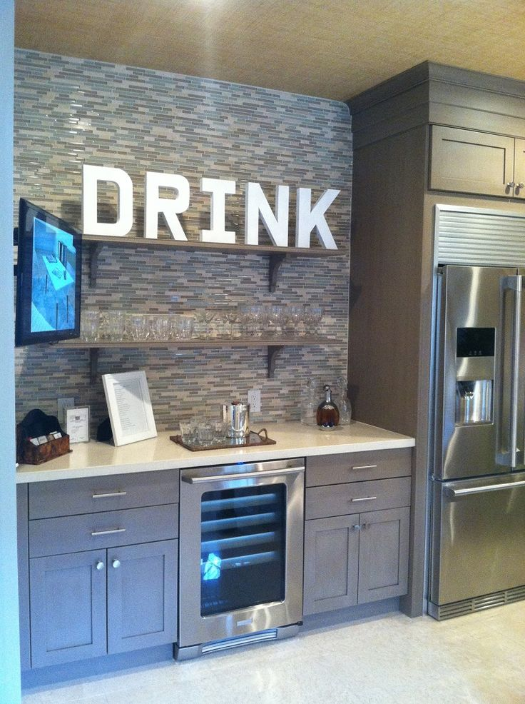 Kitchen:Impressive Small Bar Kitchen Counter With Built In Modern Beverage Center Using Chrome Frame Glass Fridge Door Also White Marble Counter Plus Wall Mount Glass Shelves Beverage Center in the Kitchen Ideas