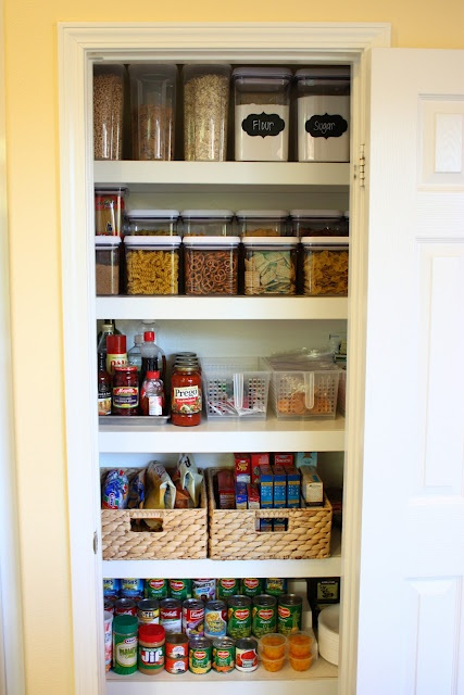 great tips for organizing a pantry...plus she loves OXO Containers :)