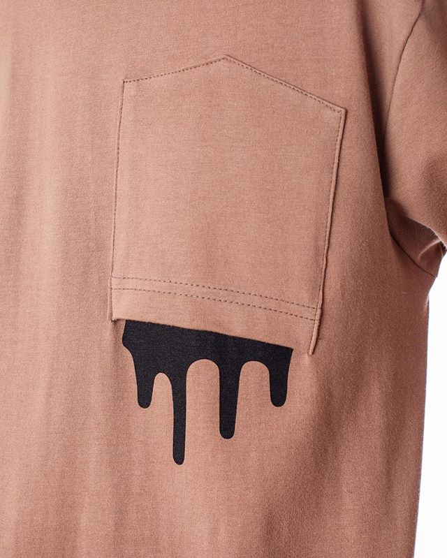 This is creative - flip a pocket on a shirt or add one if you have to and  then paint some paint drips coming out!