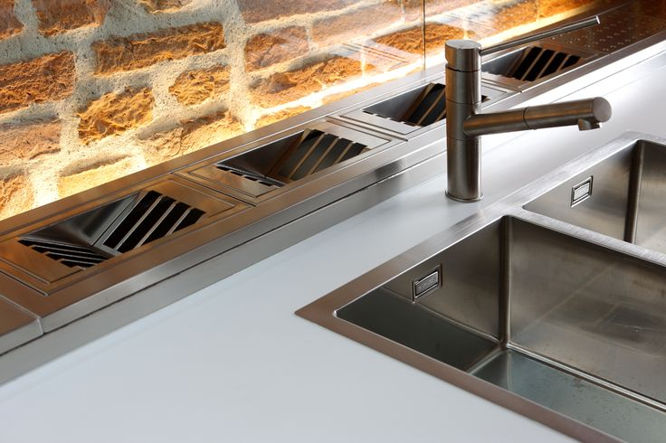 detail of the stainless steel sink and accessorised channel in stainless steel too