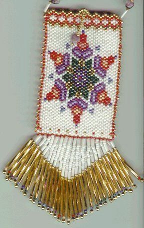 Knitted Beaded Amulet Bag Susan Rainey Page 5 Using the crochet hook, pull the twisted thread through the hole, making sure to keep it taut and NOT