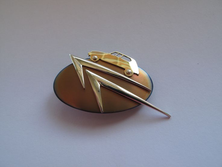 Dyane brooch  - gold, silver, titanium. Custom designs made to order. philwarddesign.com.au
