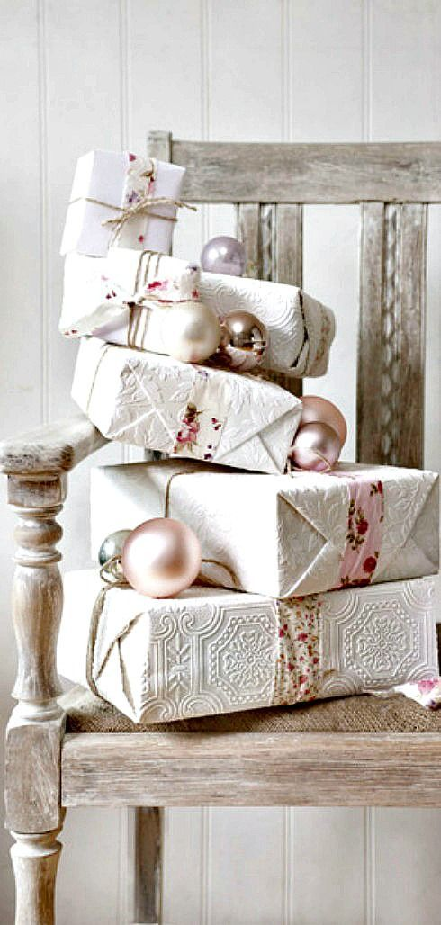 Gift wrapping from textured wallpaper tied with floral fabric ribbon and twine.
