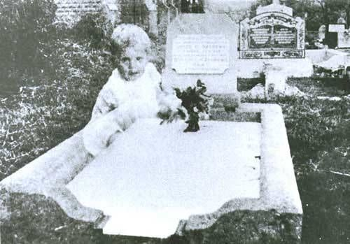 In 1946, a woman named Mrs. Andrews took this picture of her deceased daughter's gravestone in Queensland, Australia. Her daughter had been just 17 when she'd died the previous year. When the film was developed, Mrs. Andrews was shocked to see the image of an infant girl looking directly into her camera.