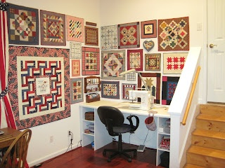 display small quilts grouped as a wall of quilts
