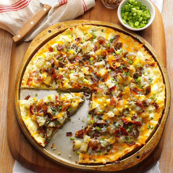 Baked Potato Pizza Recipe -I make this creative pizza for Super Bowl parties. The sour cream, bacon, onions and cheese make every bite taste just like a loaded baked potato. —Gina Pierson, Centralia, Missouri