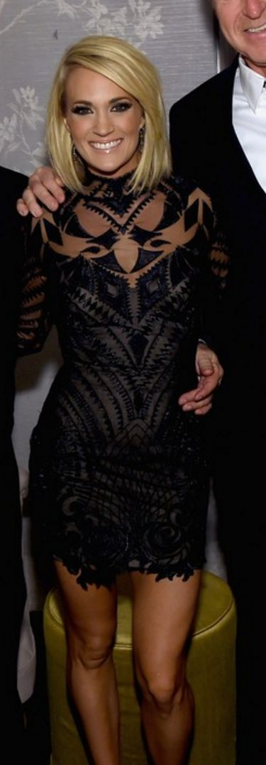 Who made  Carrie Underwood's black long sleeve mesh dress, jewelry, shoes, and clutch handbag?