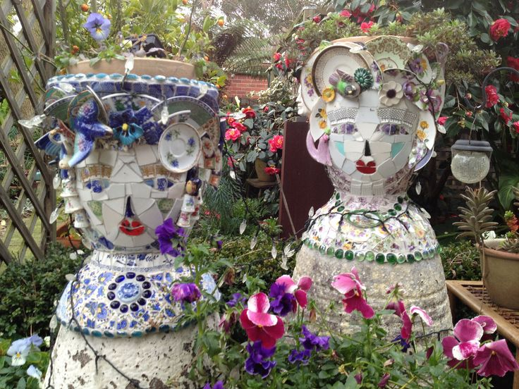 https://flic.kr/p/cvyjXy | Mosaic planters | Made on a base of garden pots assembled into the shape of a 'sort of' lady.  Inspired by Cleo Mussi and Mary McMahon.