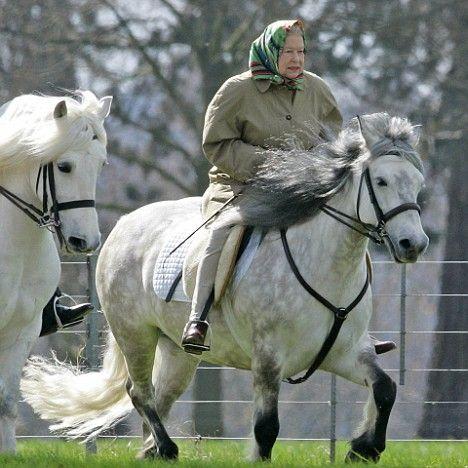 Queen Elizabeth II starting her day the best way...on horseback!