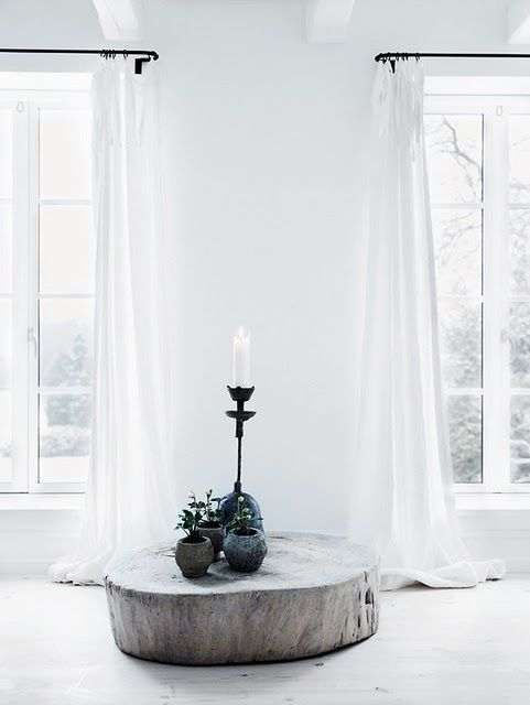 white / minimalist / long white curtains / wood / plants  Great idea for reusing the trunk of a fallen tree friend!
