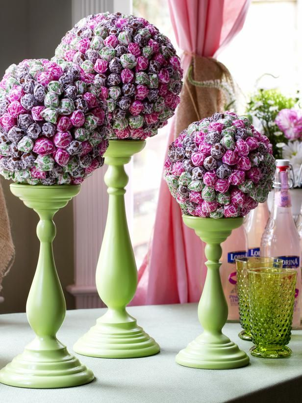 How to Make a Lollipop Topiary Centerpiece: Step one: Spray paint a candle holder Step two: start putting dum-dum suckers in the foam ball Step three: Put the ball on the candle holder and decorate somewhere... GIVE TO KIDS!!! <3 From DIYnetwork.com