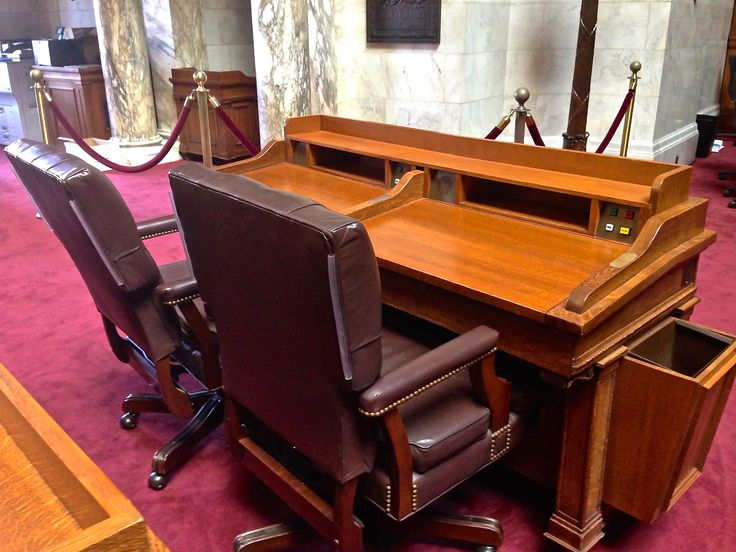 The Wisconsin Assembly is comprised of 99 State Representatives. The Representatives meet in this room at the State Capitol building in Madison.  The members vote by pushing buttons on their desk (that turn red or green lights on by their name on a voting board in the room).  The white button on the desk is used by the State Representative to call his/her assistant.  For up-to-date information on all bills visit http://legis.wisconsin.gov/.
