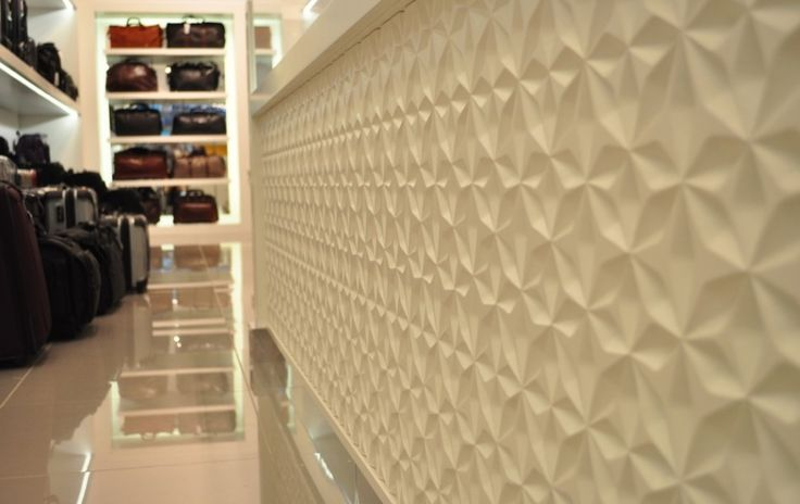 This retail is the ultimate stop with its beautiful textured wall and monochromatic color scheme.  Even the white glossy floor adds its special touch to the space.