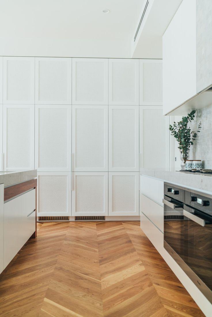 Malvern Home | GABBE | est living - chevron floors, white shaker cabinets, light grey marble benchtops
