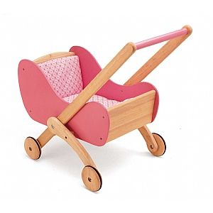 Time to take your dolls out for a stroll in this beautiful buggy! Made from natural and pink wood, it also has four rubberised wheels for an easy ride! It comes complete with the pink flowery bedding too! | From Spotty Green Frog