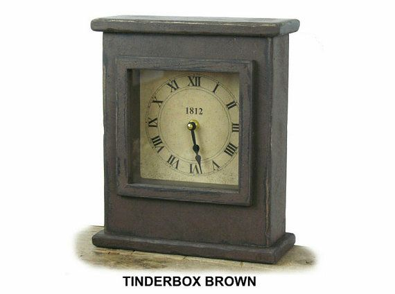 A wonderful handcrafted wooden mantel clock with vintage reclaimed window glass over the clock face. Quartz movement uses one AA battery. Time is set and battery replaced easily via a small opening in the back of the clock. The 8 3/4 x 3 1/4 x 10 tall size fits well on any fireplace mantel or shelf. This great clock is made to order in the U.S.A. and is available in 9 colors. (Colors shown are Burgundy and Tinderbox Brown)